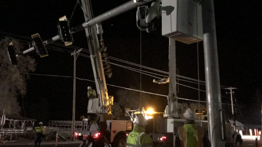 Electric crews install traffic lights at Sunnyside and Ammon Roads