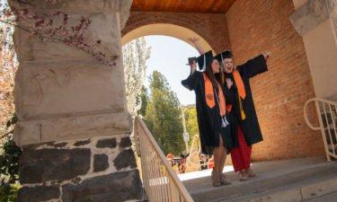 isu grads march through the arch