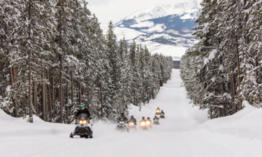 Snowmobiles riding the park road