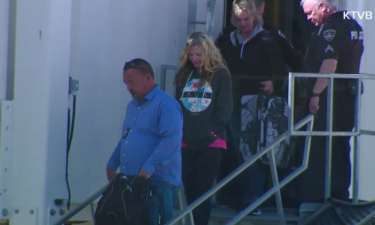 Lori Vallow steps off the plane at Boise Airport.