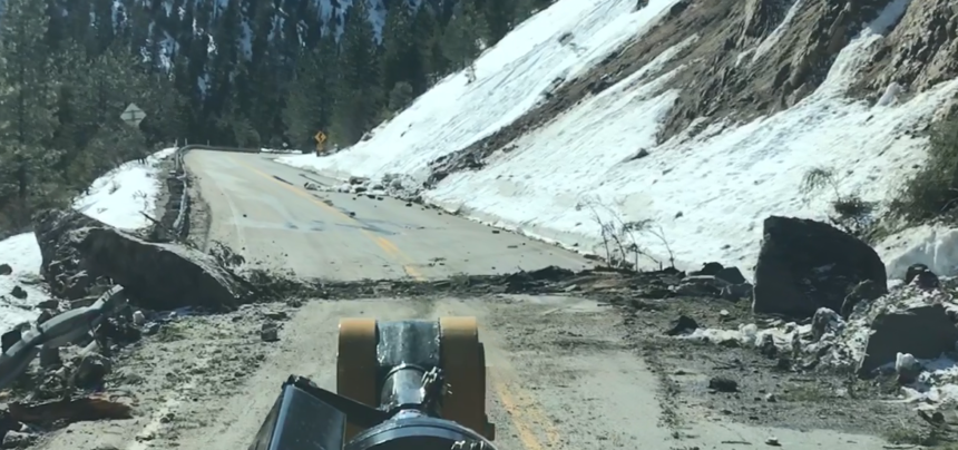 Highway 21 cleanup6_ A large boulder fell and dragged across the highway, gouging the pavement.