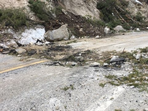 Highway 21 cleanup8_ A large boulder fell and dragged across the highway, gouging the pavement.