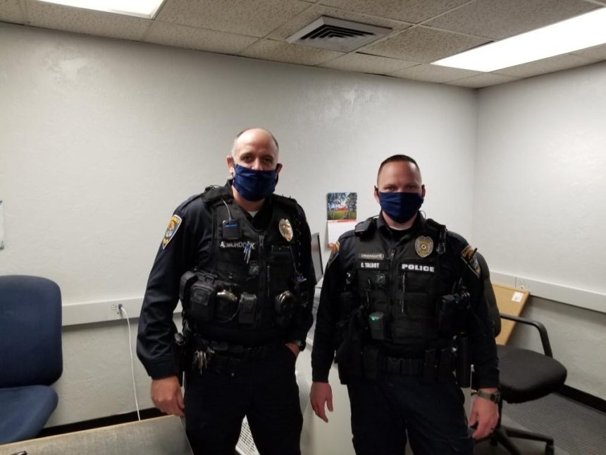 Officers wearing face masks