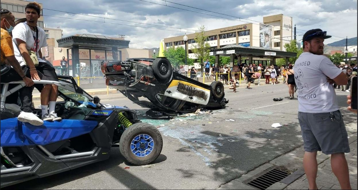SLC protest turn a police car upside down