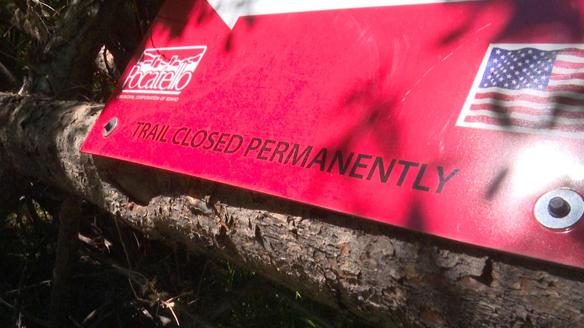 "red sign reads ""Trail Closed Permanently"""
