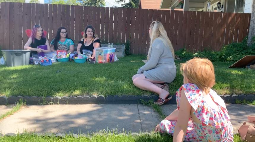 girls talking on the grass