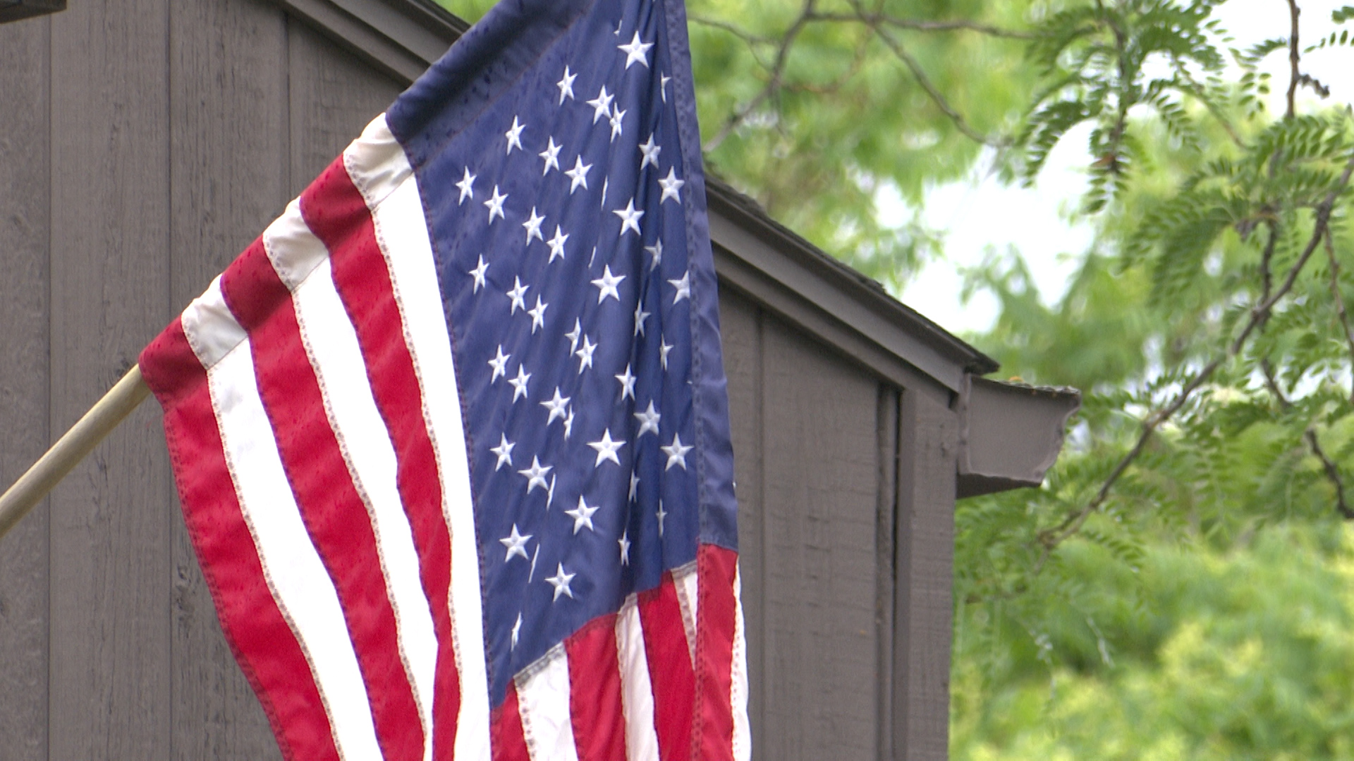 U.S. flag hangs from a front porch