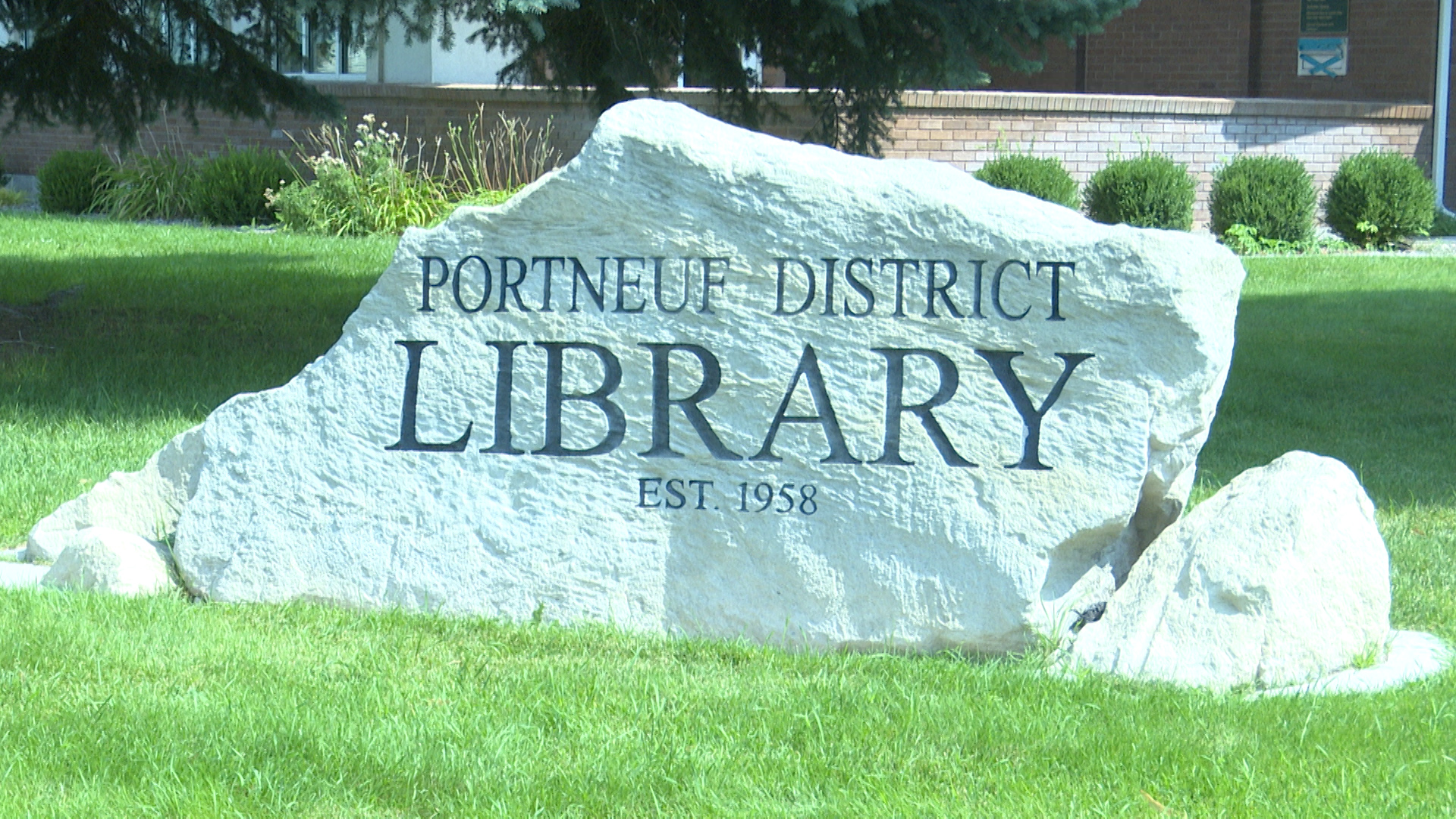 the rock in front of the library