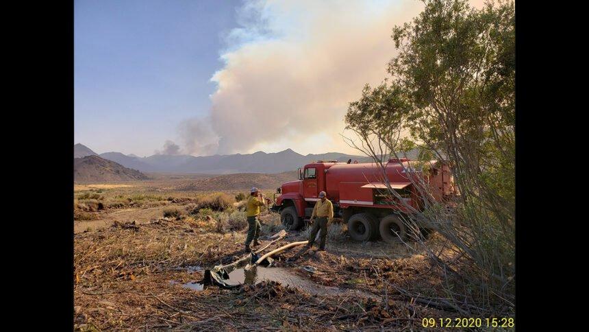 Inkom Tactical Water Tender refills from small creek, Slink Fire, Slinkard Valley, California