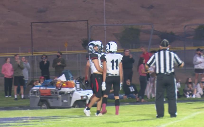 #5 Jaxon Shuman celebrates touchdown in Highland 31-13 victory over Century