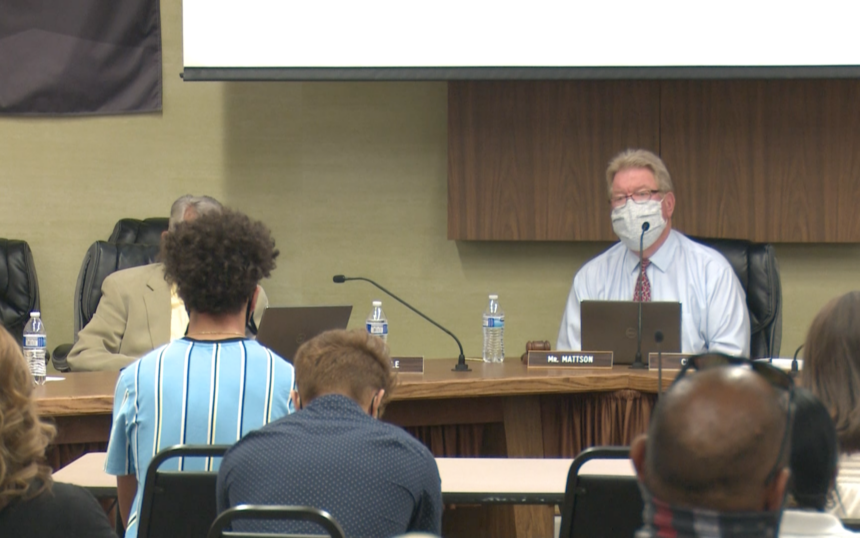 Pocatello/Chubbuck School District 25 Board Member Dave Mattson looks on as student gives his thoughts concerning the mascot decision.