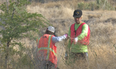 Participants in Wednesday's cleanup pick up trash alongside Hiline Road in Chubbuck