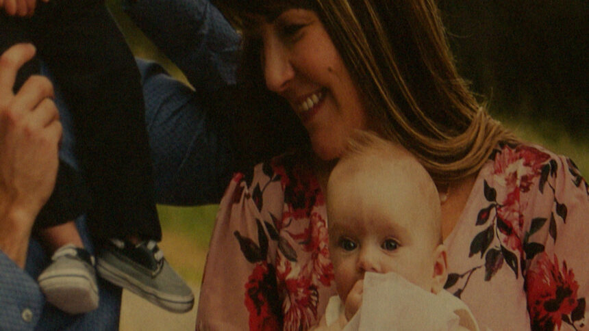 bridget holds baby belle in a family photo