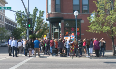 People gather outside of United Way of Southeastern Idaho for Thursday's ribbon-cutting ceremony