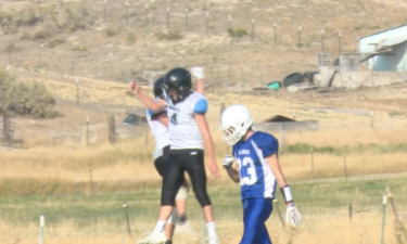 #4 Payten Sneddon and #13 Jett Shaw celebrate touchdown in Dietrich win