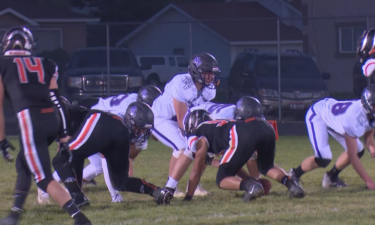 #13 QB Luke Hill lines up under center in North Fremont's 22-14 win over Aberdeen