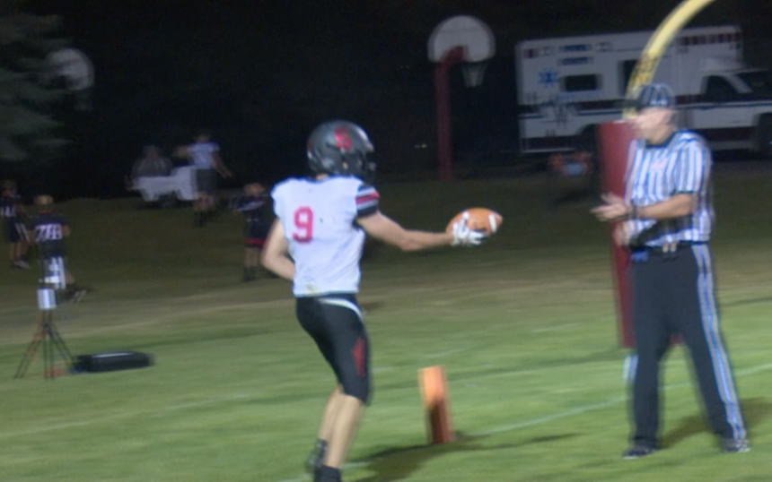 #9 Scott Hunsaker hands the ball to referee following touchdown in 33-14 win.