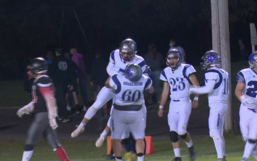 #60 Nick Paris celebrates with #7 Trey Poulter in Snake River's 21-0 win