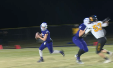 #19 QB McKean Romreill rolls out to pass in Century's 33-14 win over Bishop Kelly