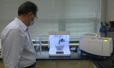 Assistant Professor Dr. Ali Hibashi uses 3D bioprinting machine at Leonard Hall on ISU campus