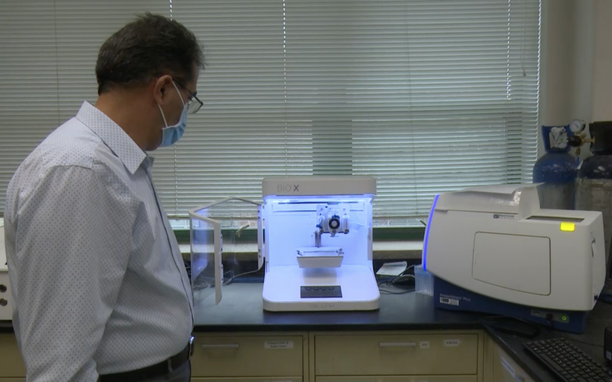 Assistant Professor Dr. Ali Hibashi uses 3D bioprinting machine at Leonard Hall on ISU campus