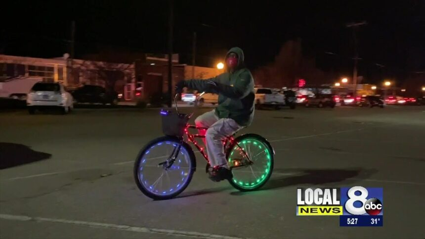 Leonard Adams spreading Christmas cheer on his lighted bike