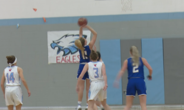 #11 Kylie Larsen finishes at the rim in Preston's 53-28 win over Marsh Valley