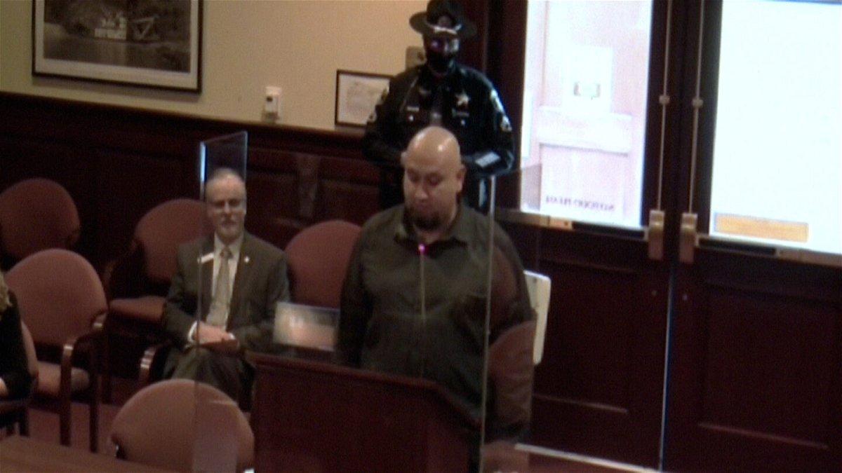 Christopher Tapp speaks in favor of the Wrongful Conviction Act alongside bill sponsor Senator Doug Ricks.