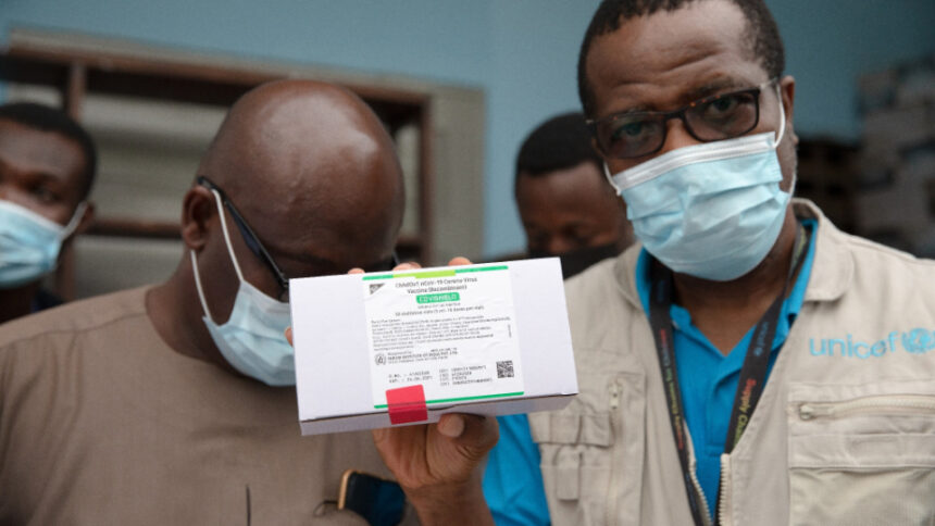 UNICEF staff show boxes containing the first shipment of COVID-19 vaccines distributed by the COVAX Facility in Accra, Ghana, on February 24, 2021. UNICEF:UN0421763:Kokoroko