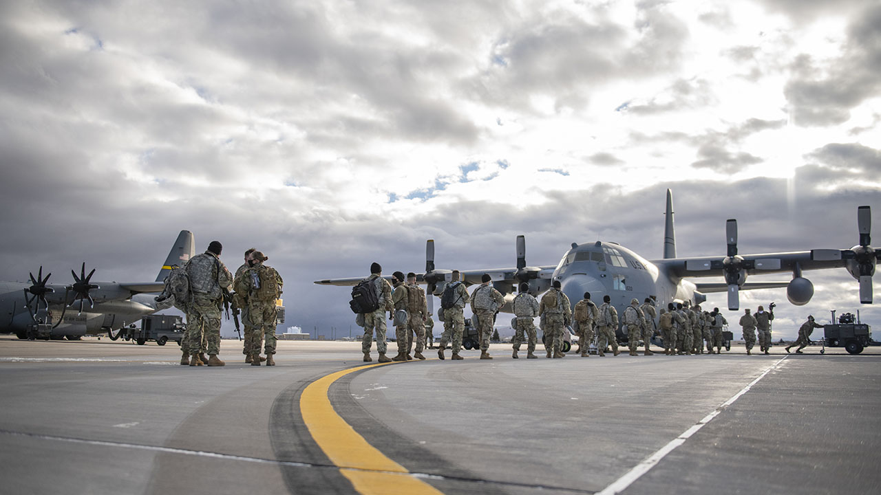 Soldiers and Airmen with the Wyoming National Guard load onto a C-130 aircraft at the 153rd Airlift Wing, Cheyenne, Wyo., Jan. 16, 2021.