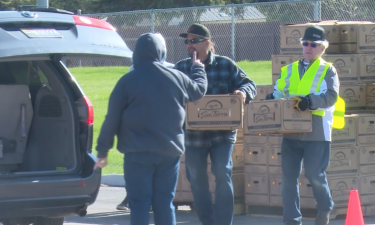 Members of Calvary Church in Pocatello hand out food boxes