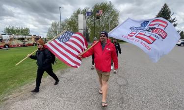 Members of Carry The Load march at Vietnam Veterans Memorial in Idaho Falls, ID