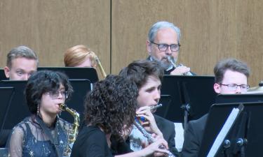 Richard Landauer performs with students at Thunder Ridge High School