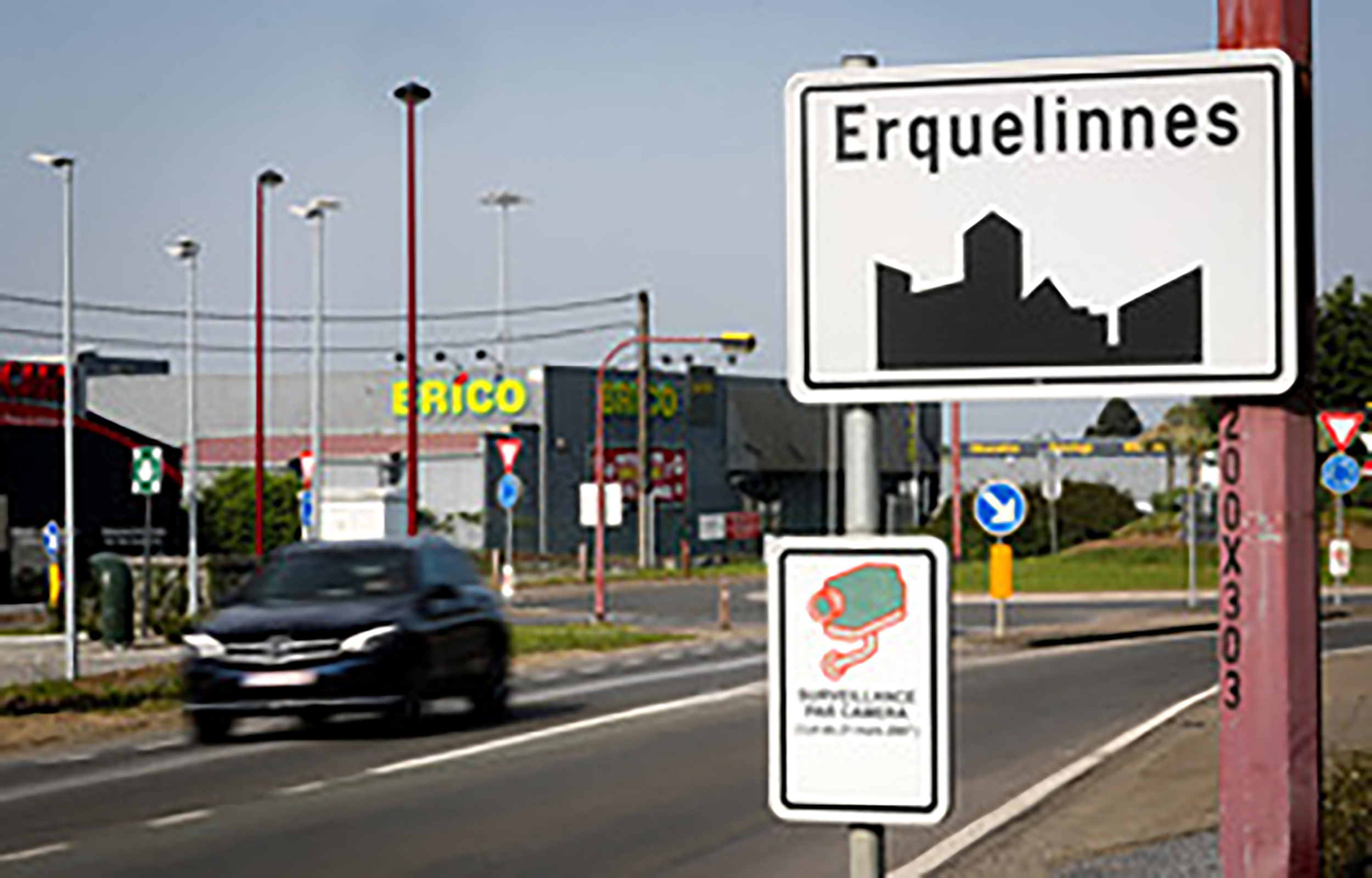 Illustration shows the name of the Erquelinnes municipality on a road sign, Tuesday 22 May 2018.