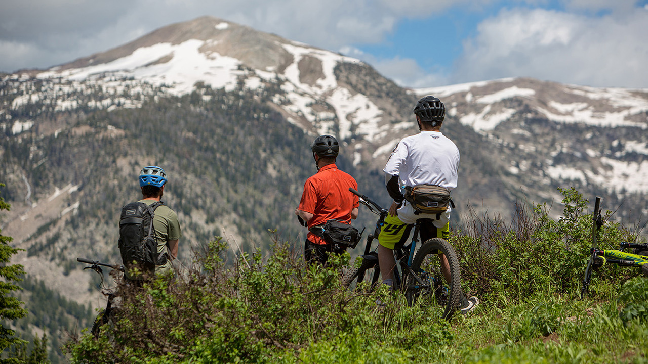Some mountain bikers take in the Tetons while they take a break from riding Grand Teton's renowned trails.