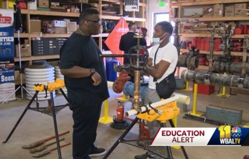 Matthew Roundtree (left) and Marvin Parker (right) are among the first group of high school graduates taking part in a new apprenticeship program designed to help them get jobs.