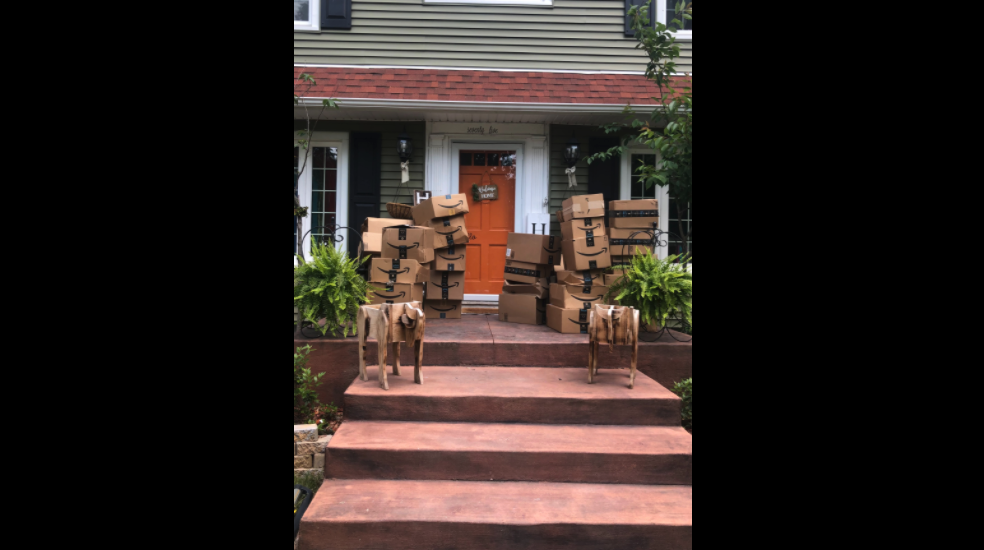 A New York woman is giving back to the community after more than 150 Amazon boxes that did not belong to her showed up at her house.