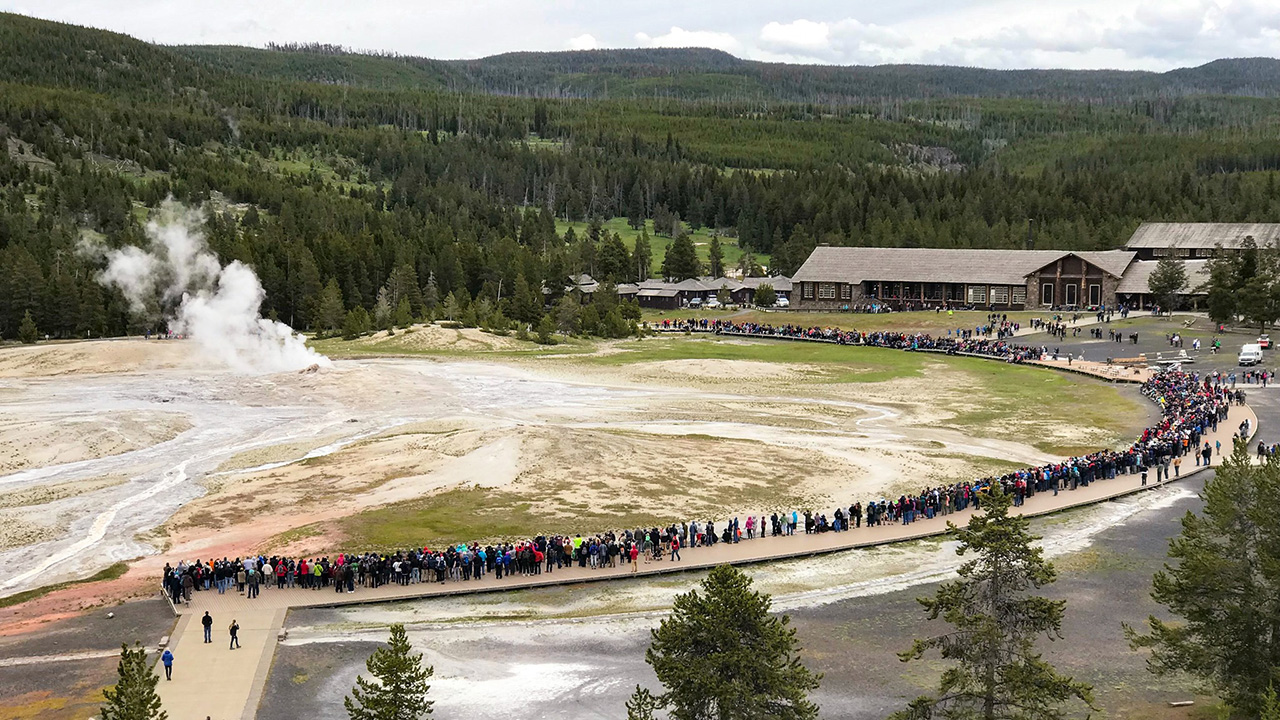 Crowds gather for an Old Faithful Eruption