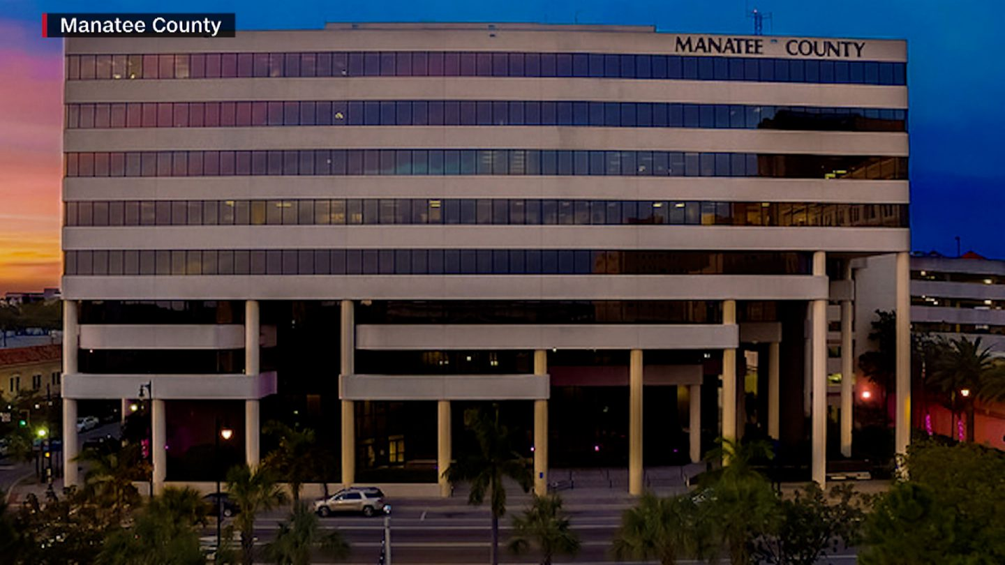 Two people are dead and four of their coworkers were hospitalized after a Covid-19 outbreak swept through a government building in Manatee County, Florida.
