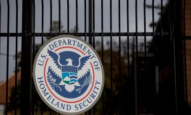 The U.S. Department of Homeland Security (DHS) seal hangs on a fence at the agency's headquarters in Washington