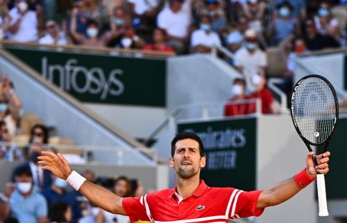 Serbia's Novak Djokovic reacts during his men's final tennis match against Greece's Stefanos Tsitsipas on Day 15 of The Roland Garros 2021 French Open tennis tournament in Paris on June 13.