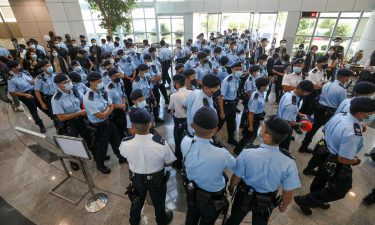 Police officers raid the Apple Daily office on June 17 in Hong Kong.