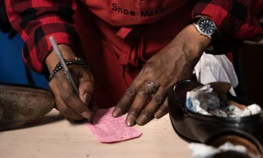 A shoe cobbler working in a black-owned business in Washington