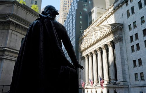 The Federal Hall statue of George Washington overlooks the New York Stock Exchange on June 7. The Dow fell 400 points shortly after the opening bell Friday.
