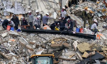 Rescue workers search in the rubble at the Champlain Towers South condominium on June 30 in the Surfside area of Miami.
