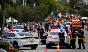 Police and firefighters respond after a truck drove into a crowd of people injuring them during The Stonewall Pride Parade and Street Festival in Wilton Manors