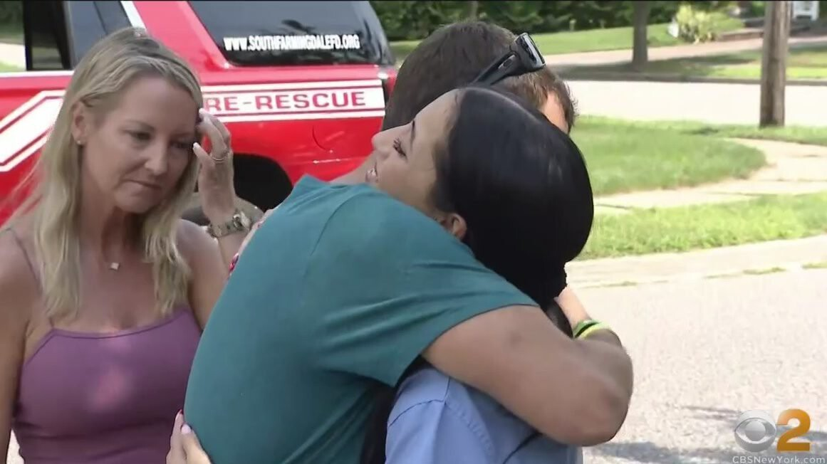 <i>WCBS</i><br/>19-year-old Antonina Barry noticed flames coming from her neighbors' house and got three people and their dog out of their burning home