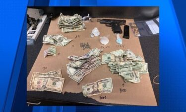 Portland police say a large amount of drugs and money were seized while officers were conducting a welfare check on a vehicle on Tuesday.