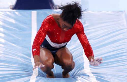 Simone Biles of Team United States stumbles upon landing after competing in vault during the women's team final on day four of the Tokyo 2020 Olympic Games at Ariake Gymnastics Centre.
