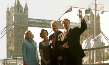 US President Bill Clinton and his wife Hillary pose in front of London's Tower Bridge with British Prime Minister Tony Blair his wife Cherie